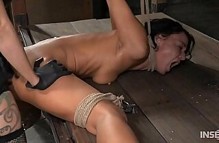 Contortionist gets her tits fucked in lezdom bondage