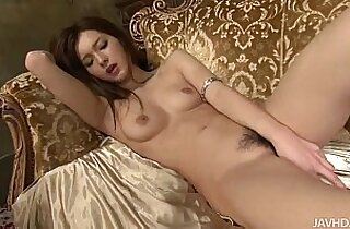 Lovely Mei looks fantastic in and on gold as she toys her sweet pussy